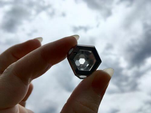 holding a single ARK crystal