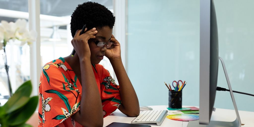 stressed woman at computer desk