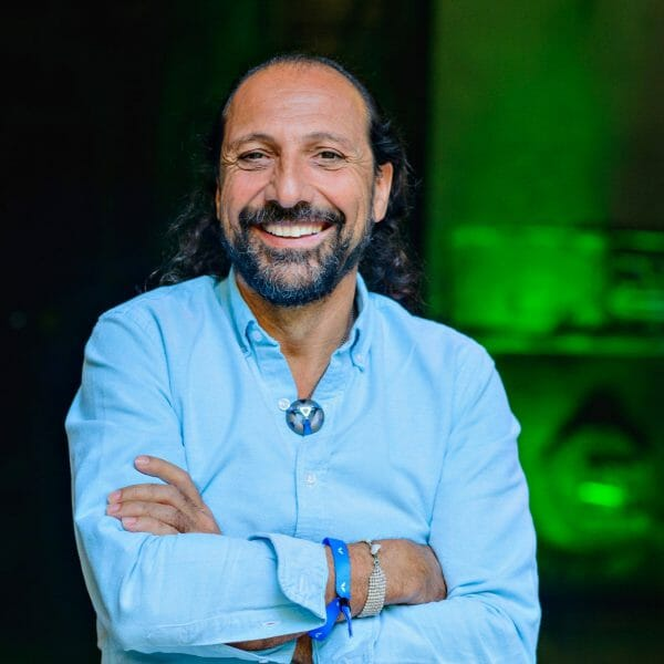 physicist Nassim Haramein wearing classic ARM pendant ARK crystal