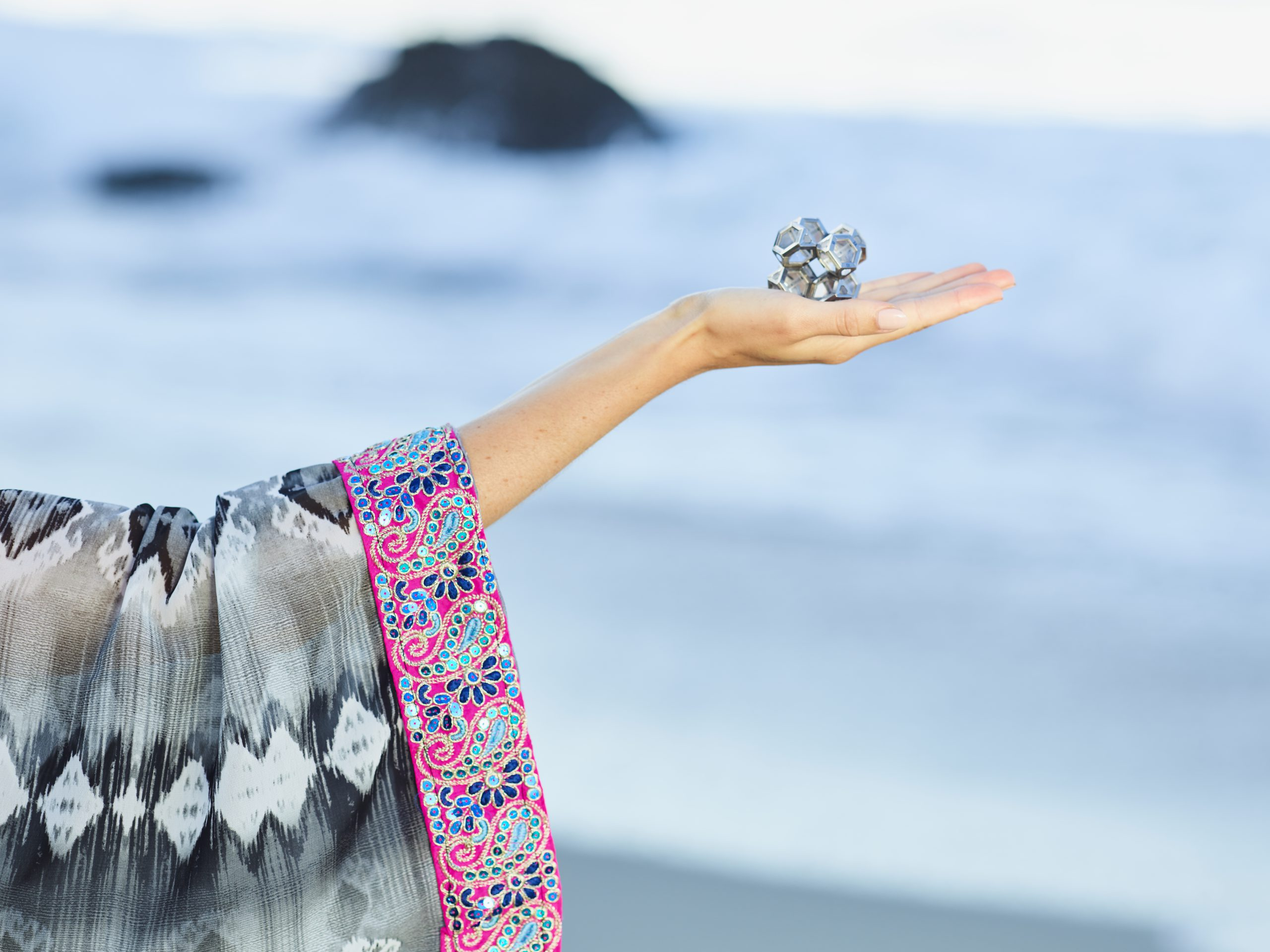 woman holding the ARK crystal 8 geometric assembly